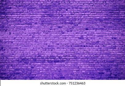 A large lilac wall made of bricks.