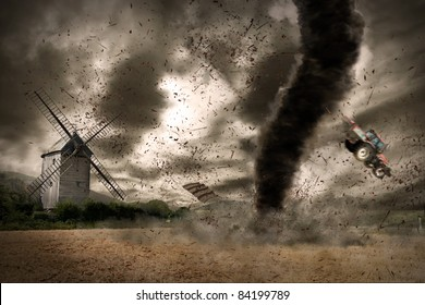 Large tornado over a wind mill