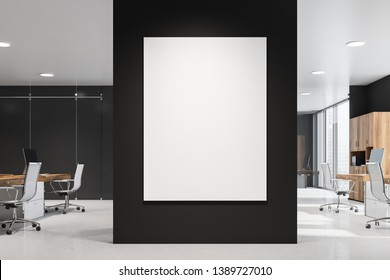 Large vertical poster hanging in modern office interior with black walls, rows of computer tables and wooden bookcases. Concept of advertising and marketing. 3d rendering mock up