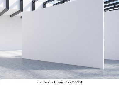 Large white wall in center of room in attic with glass roof. Concept of contemporary design trends. 3d rendering. Mockup