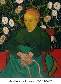 LArlesienne: Madame Joseph-Michel Ginoux, by Vincent Van Gogh, 1888-89, Dutch Post-Impressionist. This is an oil on canvas painting of Marie Ginoux, the proprietress of the Caf_ de la Gare, wearing th