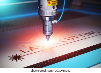 Laser cutting metal industry: macro view of industrial digital CNC - computer numerical control CO2 invisible laser beam cutter machine cutting stainless steel sheet with lot of bright shiny sparkles