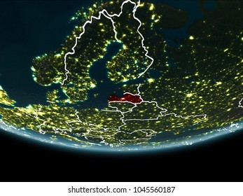 Latvia highlighted in red on planet Earth at night with visible borders and city lights. 3D illustration. Elements of this image furnished by NASA.