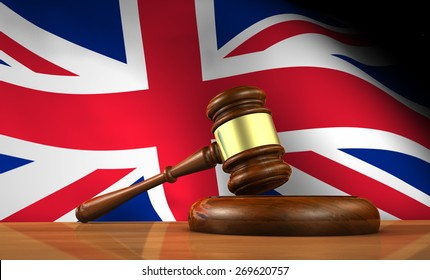 Law and justice of United Kingdom concept with a 3d rendering of a gavel on a wooden desktop and the Union Jack Uk flag on background.