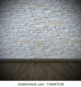 layered stone wall with dark wooden floor
