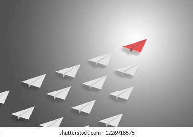 leadership concept creative ideas unique red airplane flying leader the team in the sky direct to the best success teamwork together. group of plane fly follow up the leader to win successful.
