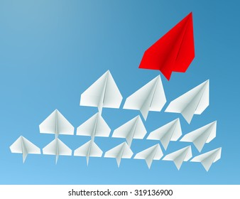 Leadership concept. One red leader plane leads other white planes forward