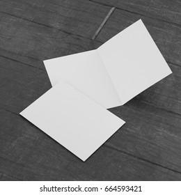 Leaflet or brochure or greeting card on wooden floor. 3D rendering