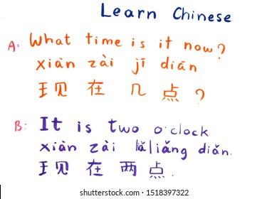 Learn Chinese alphabet and word. Hanzi and hanyu in simplified chinese alphabet studying. Chinese hand writing on paper by human hand color writing. Studying time conversation