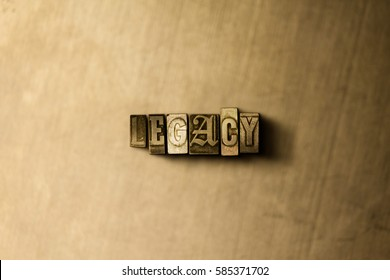 LEGACY - close-up of grungy vintage typeset word on metal backdrop. Royalty free stock illustration.  Can be used for online banner ads and direct mail.