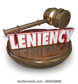 Leniency wrod in red 3d letters by a judge's gavel to illustrate merciful sentencing in a legal court case or trial