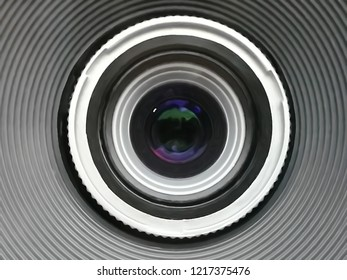 Lens of photo / video camera. Hi-tech optics. Optical device / equipment. Abstract geometric background with round notches and concentric rings on the subject of science and modern technology,