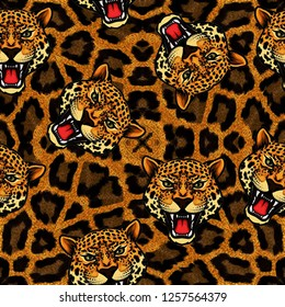 Leopard faces on brown leopard pattern. Fabric, textile pattern.
