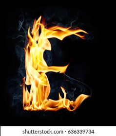 Letter E. Fire and smoke alphabet over black background
