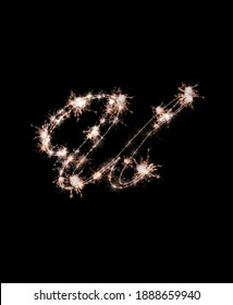 the letter u made from sparks of Bengal lights isolated on a black background. beautiful letters.