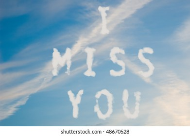 The letters I miss you written with cloud letters.