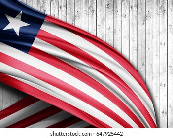 Liberia flag of silk with copyspace for your text or images and wood  background -3D illustration