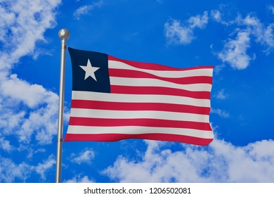 Liberia Islands national flag waving isolated in the blue cloudy sky realistic 3d illustration