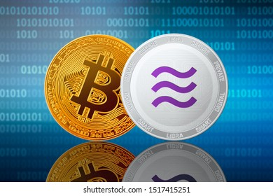 Libra and Bitcoin coins on the binary code background; facebook libra and bitcoin cryptocurrency