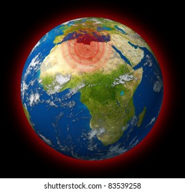 Libya conflict global hot spot represented by the planet earth with Africa in focus showing red radiating concentric circles targeting the crisis in Libyan territory of revolution and war.