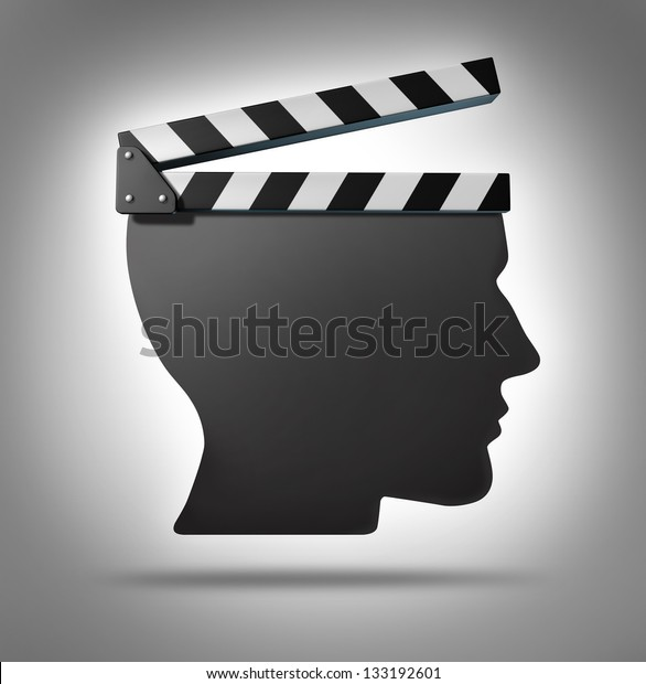 Life direction and human guidance as a symbol of a movie equipment clapboard shaped as a head ins a concept for living and taking action in your biography.