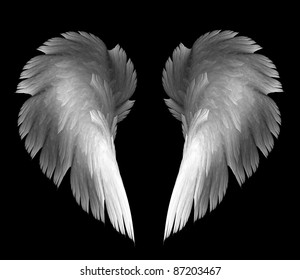 light angel wings on a black background