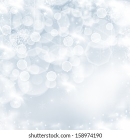 Light blue abstract Christmas background with white snowflakes