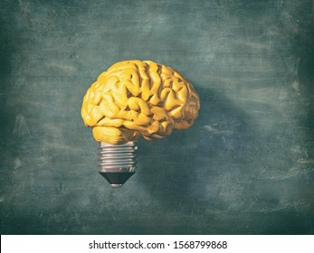 Light bulb with a yellow brain instead of the glass.  this is a 3d render illustration