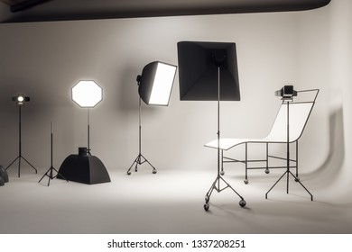 Light concrete photo studio interior with professional equipment. Photography and design concept. 3D Rendering