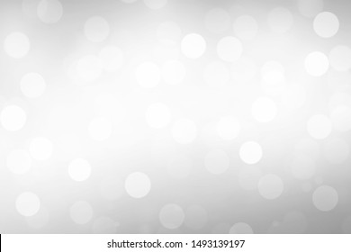 Light Silver Abstract Christmas Background With White Bokeh Lights