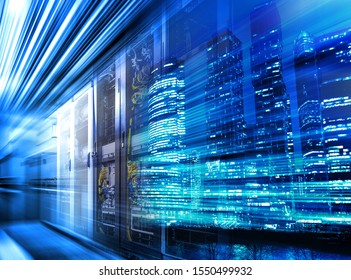 Light trails on modern building background and data center servers are on move. Concept big data in motion. Blue toning
