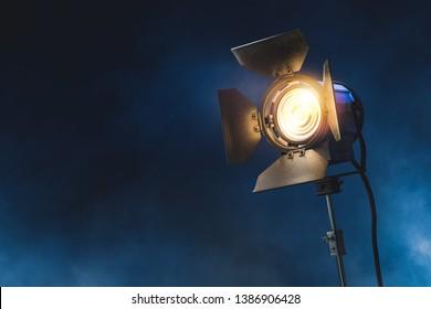 light used for movie making on a dark blue background / 3D rendering, illustration.