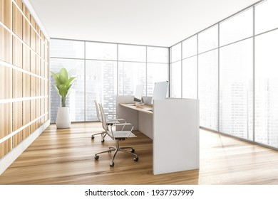 Light wooden office interior with white desk and armchairs with computers, plant on parquet floor, side view. City view on skyscrapers, 3D rendering no people