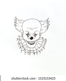 Line drawing with a pencil of a clown skull. Male clown skull on a white background