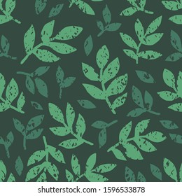 Linocut green leaves on dark background. Seamless green leaves linocut grunge pattern. Linocut seamless print. Great for label, print, packaging, fabric.