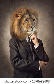 Lion in a suit. Man with a head of an lion. Concept graphic in vintage style with soft oil painting style.