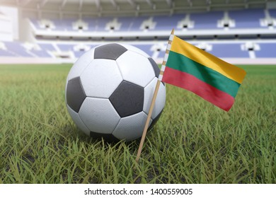 Lithuanian flag in stadium field with soccer football