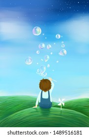 Little boy blowing bubbles on the grass in summer