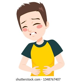 Little boy kid touching his belly having terrible stomachache pain