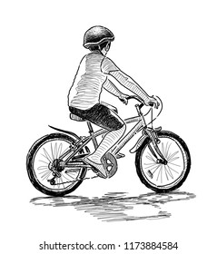 A little boy rides a bike