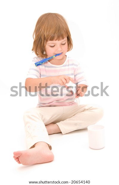 little, cute girl washing her teeth, isolated on white