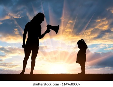 A little girl standing crying and her mother shouting at her into the loudspeaker. The concept of child abuse