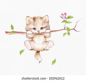 Little kitten hanging on the tree