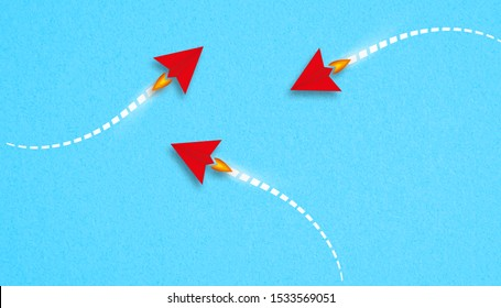little red airplanes symbolizing a different approaches on paper background