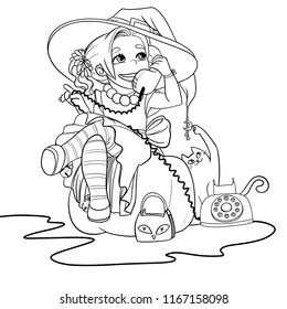Little witch with a phone in her hands