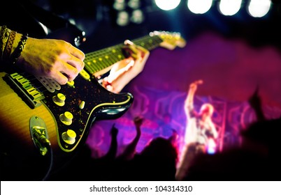 live music background,Guitar player and public