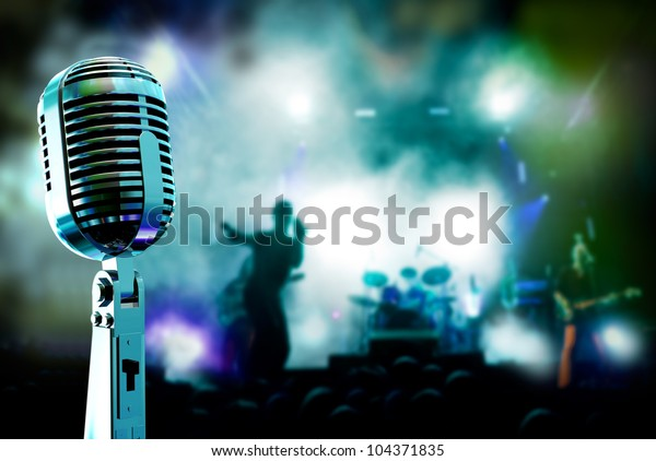 Live music background.Microphone and band