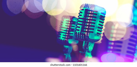 Live music background.Microphone and stage lights.Concert and music concept.3d illustration