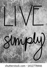 Live Simply on black and gray