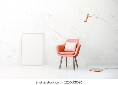 Living coral. The color of the year 2019. The interior wall mock up with a living coral color of chair and copper metal lamp at marble wall. Poster mock up with vertical metal frame. 3d illustration.